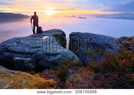 Sharp Rear Man Silhouette On Rocky Peak. Satisfy Hiker Enjoy View. Tall Man On Rocky Cliff