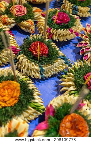 Krathong, the hand crafted floating candle made of floating part decorated with green leaves colorful flowers and many sorts of creative materials for sale on festival Loy Krathong in Thailand