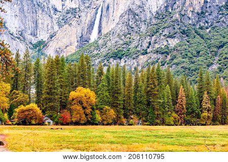 Yosemite National Park Valley with Yosemite Falls at cloudy autumn morning. California, USA.