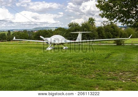Beautiful small private aircraft with propeller waiting for start
