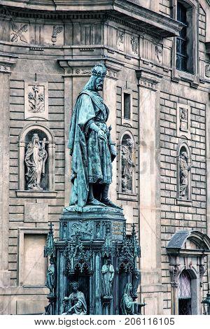 Old statue of Charles IV and St. Francis of Assissi church Prague Czech republic. Blue photo filter. Architectural theme.