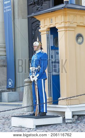 STOCKHOLM - AUG 26 2017: Royal guard in blue uniform and a rifle guarding the swedish royal castle in Stockholm. August 26 2017 in Stockholm Sweden