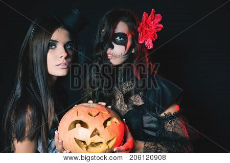 Entrance is limited to nightclub, dress code. Fashion young women going to Halloween party 2017. Beautiful woman like doll. Hallowen costumes