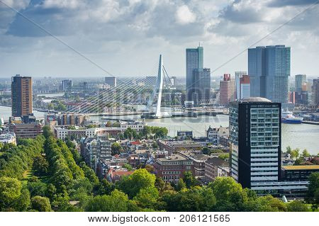 ROTTERDAM, THE NETHERLANDS - Sep. 6, 2017: Rotterdam skyline with Erasmus bridge. Aerial view of Rotterdam, The Netherlands. A major logistic and economic centre, Rotterdam is Europe's largest port.