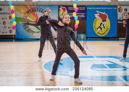 Kamenskoye Ukraine - March 9 2017: Championship of the city of Kamenskoye in cheerleading among solos duets and teams young cheerleaders perform at the city cheerleading championship