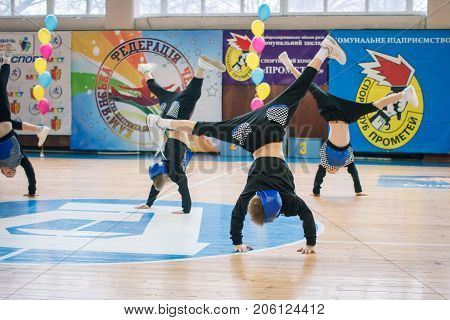 Kamenskoye Ukraine - March 9 2017: Championship of the city of Kamenskoye in cheerleading among solos duets and teams young boys cheerleaders perform at the city cheerleading championship