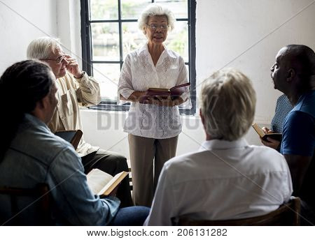Group of christianity people reading bible together