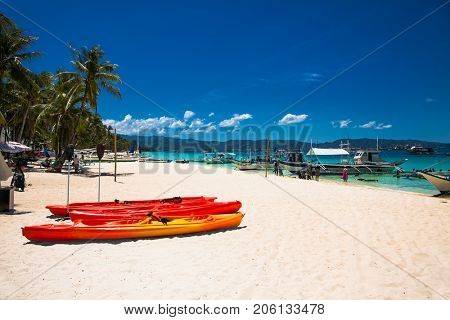 Diving's boat and kayak at famous White Beach on Boracay Island, Philippines.