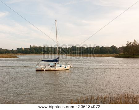 Single Private Boat Moored In River High Tide Landscape Scene