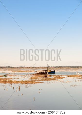 Boat Moving Through Estuary River Stream With Plenty Of Water Space