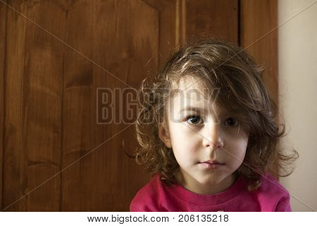 A girl with an attentive look and disheveled hair