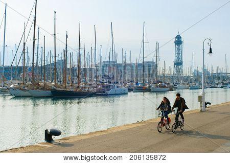 Couple Riding Bikes. Barcelona, Spain