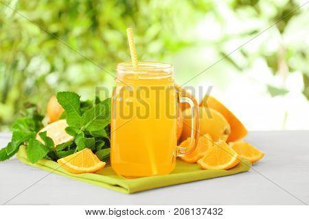 Freshly squeezed orange juice in jar on table