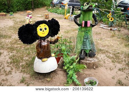 Cartoon characters made of secondary raw materials on playground