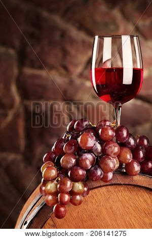 Red Wine.still Life With Glass Of Red Wine, Grapes And Barrel.selective Focus.wine Cellar Atmosphere
