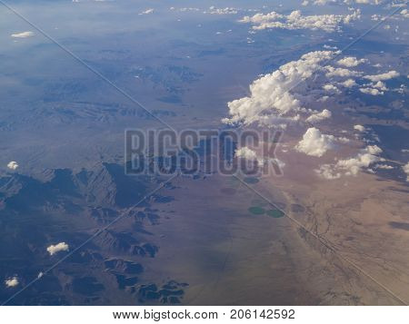 Aerial View Of Mountain Landscape, View From Window Seat In An Airplane