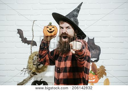 Halloween Man With Pumpkin In Witch Hat