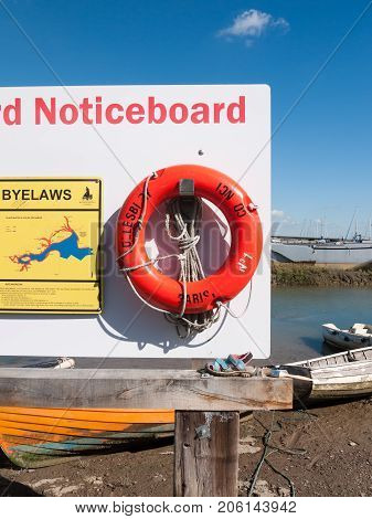 Close Up Of Red Life Buoy On Notice Board Dock Safety From Drowning