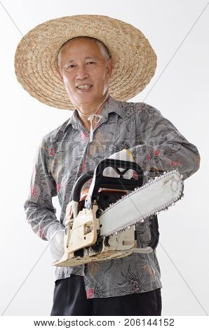 Portrait of old Asian man hand holding chainsaw standing isolated on white background.