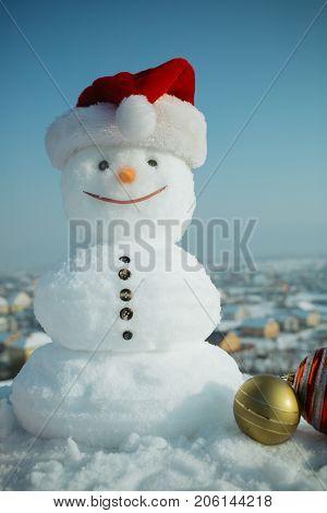 Snowman In Red Santa Claus Hat.