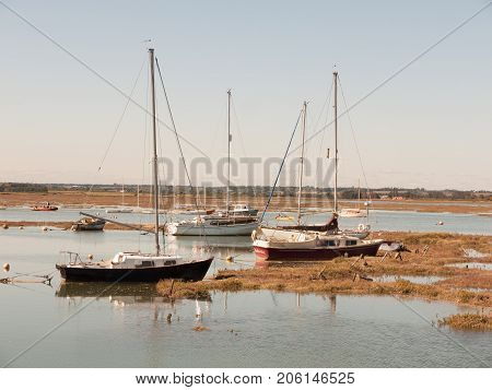Several Private Big Boats Parked In Estuary With Masts