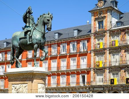 MADRID,SPAIN - AUGUST 4,2017 : The Plaza Mayor, a major landmark in central Madrid with the equestrian statue of Philip III