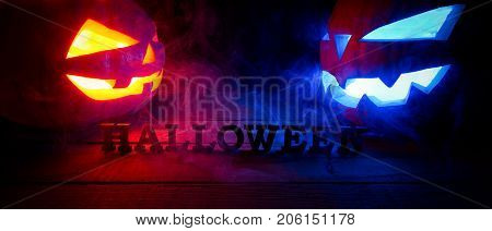 The Concept Of Halloween. Two Glowing Oranjous And Blue Light Angry Scary Pumpkin With Smoke, Jack-l