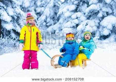 Kids On Sleigh Ride. Children Sledding. Winter Snow Fun.