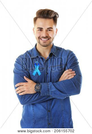 Young man with blue ribbon on white background. Prostate cancer concept