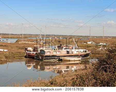 Boats Parked Along Estuary Marshland In Tollesbury Maldon