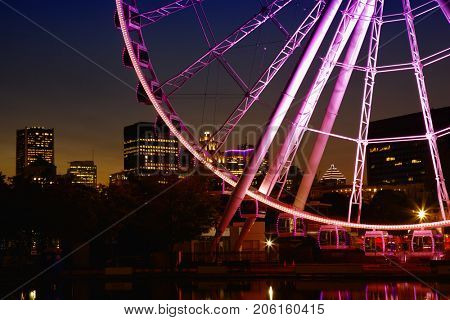 Great wheel of Montreal with his panoramic view 60 of meters high, and a breathtaking view of the river, Old Montreal and downtown city during the evening