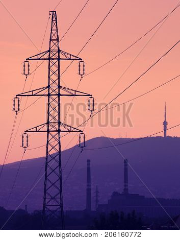 Electric wire tower chimney and tv-tower at sundown
