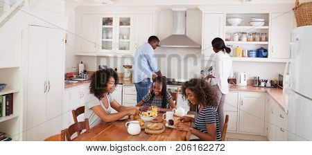 Letterbox Format Shot Of Family Using Digital Devices At Home