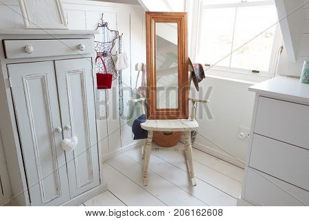 Close Up Of Mirror And Furniture In Stylish Bedroom