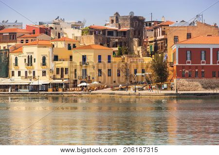 CHANIA, GREECE - APRIL 3, 2017 : Old Venetian harbour of Chania on Crete, Greece. Chania is the second largest city of Crete and the capital of the Chania regional unit.