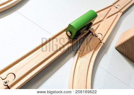 Green Car Toy On Wooden Track Isolated On White