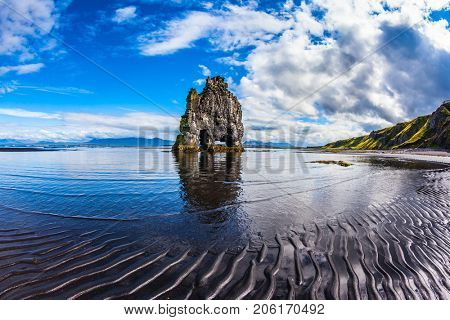 Scala Hvitsercur on the sea beach in the form of a huge mammoth. Northern coast of Iceland. Ocean outflow at sunset. Concept of extreme northern tourism