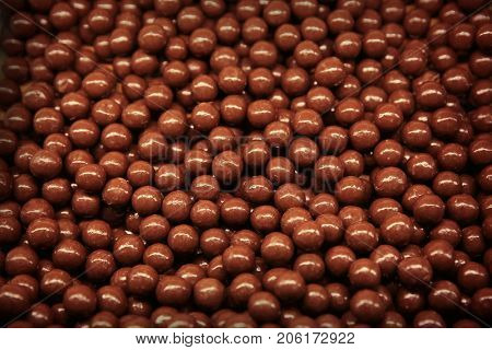Closeup of chocolate dragees as background
