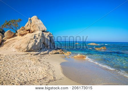 Spaggia di Santa Giusta beach with famous Peppino rock with azure clear water Costa Rei Sardinia Italy. Sardinia is the second largest island in the Mediterranean Sea.