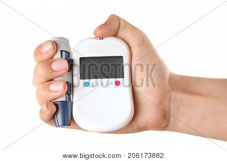 Woman's hand holding digital glucometer and lancet pen on white background. Diabetes concept