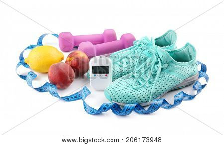Composition with digital glucometer, fresh fruits and sport inventory on white background. Diabetes concept