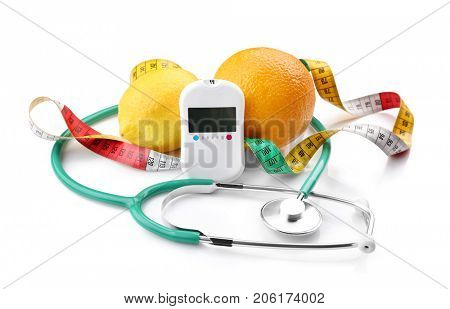 Composition with digital glucometer, stethoscope and fresh fruits on white background. Diabetes concept