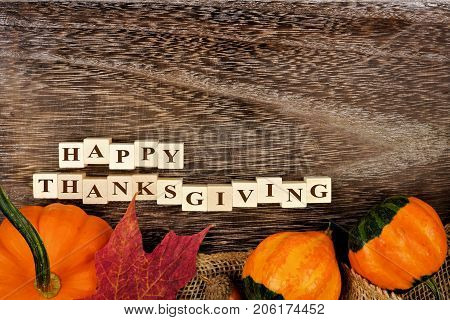 Happy Thanksgiving Wooden Blocks, Above View With Autumn Bottom Border Over Rustic Wood