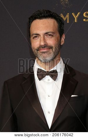 LOS ANGELES - SEP 17:  Reid Scott at the 69th Primetime Emmy Awards - Arrivals at the Microsoft Theater on September 17, 2017 in Los Angeles, CA