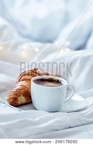 cup coffee with croissant