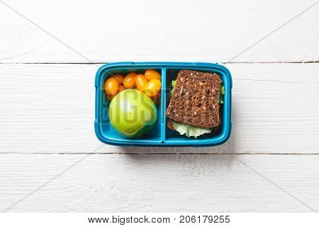 Photo of healthy food, apple, tomato, sandwich in box