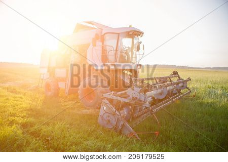 Picture of combine at work in field