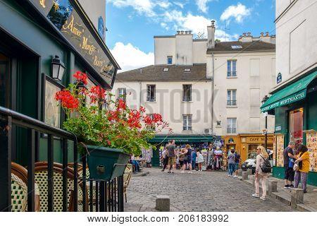 PARIS,FRANCE - AUGUST 4, 2017 : Tourists walking the streets of Montmartre