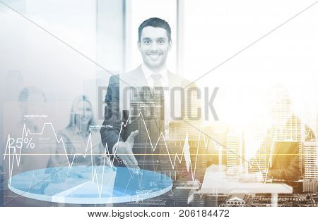 business, marketing and people concept - handsome businessman with open hand ready for handshake with charts over city background and double exposure effect