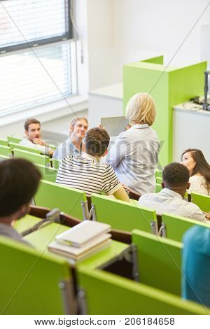 Students and teacher in universtiy in lecture hall